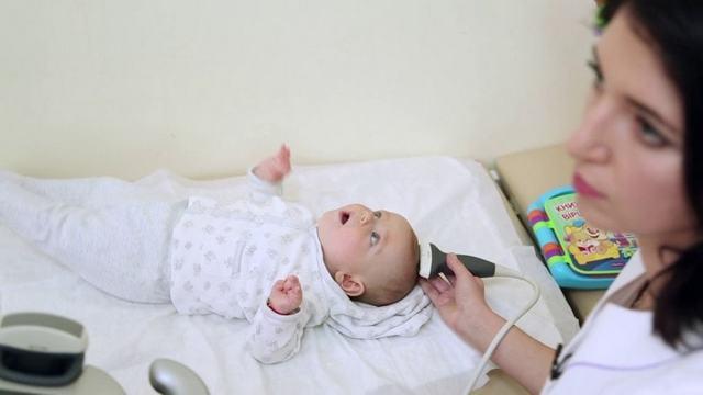 Киста в голове у новорожденного: причины и избавление от патологии